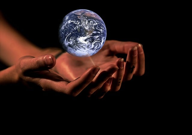 hands-globe-earth-protection-ecological-footprint