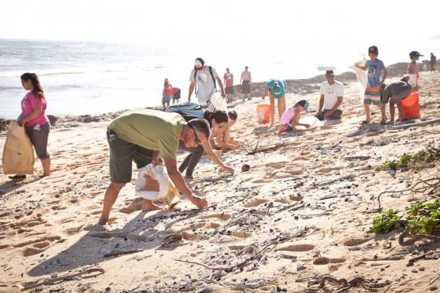 people cleaning beach